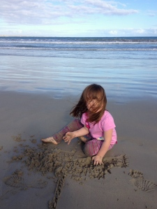 Matilda playing on the beach