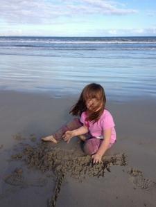 Matilda playing on the beach